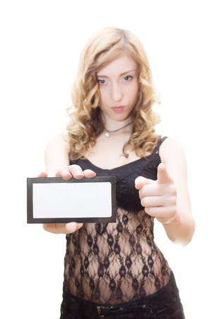Blonde in black lingerie holding blank card and pointing isolated on white Stock Photo - 4501295