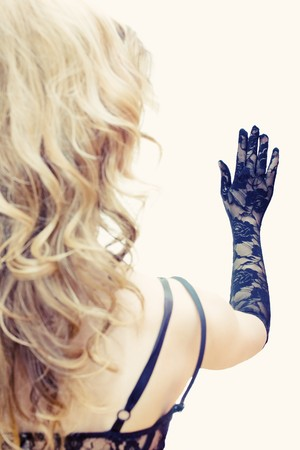 Out of focus blonde looking at hand in lace glove Stock Photo - 4542625