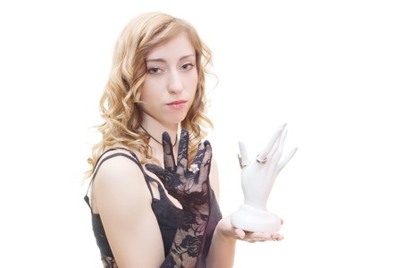 Blonde with black glove holding ring support isolated on white Stock Photo - 4542623