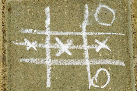 Tic tac toe game drawn with chalk on asphalt Stock Photo - 4763184