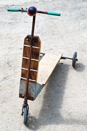 Self-made push stand up scooter from wood for kids photo