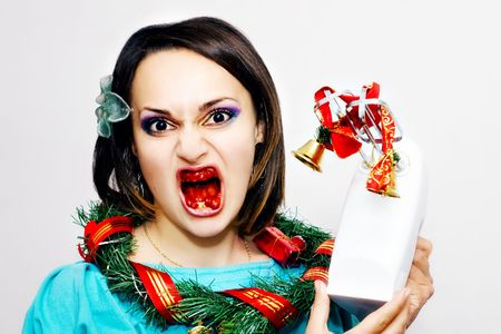 Evil girl with blood in her mouth, Christmas wreath on neck and bells winded on hand mixer Stock Photo - 5218869