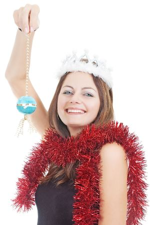 Smiling Miss Santa in white crown holding a Christmas tree ball isolated on white Stock Photo - 6030599