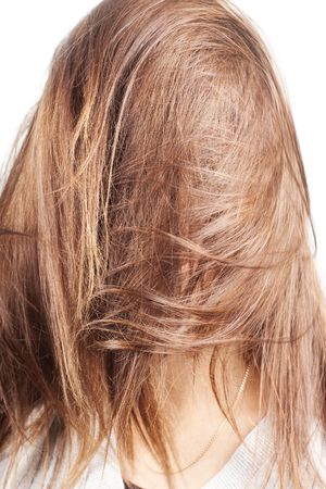 face covered: chestnut natural long hair covering face of a woman with selective focus isolated on white Stock Photo