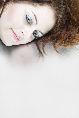 Closeup of a woman's face with blue eyes against grey background with copy space Stock Photo - 6069779