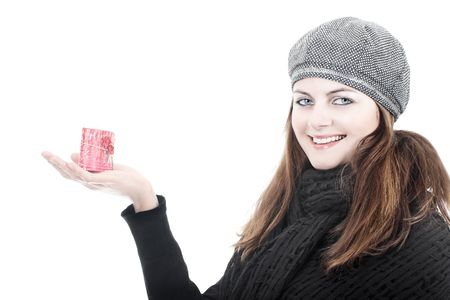 Smiling beautiful young woman in winter hat and scarf holding red love candle isolated on white Stock Photo - 6081540