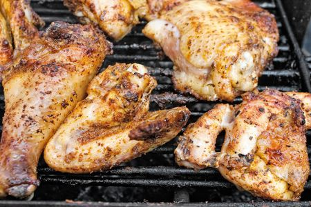 Closeup of chicken meat on barbecue grill with selective focus Stock Photo - 6672820
