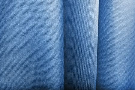 creases: Abstract blue textile texture with selective focus on creases