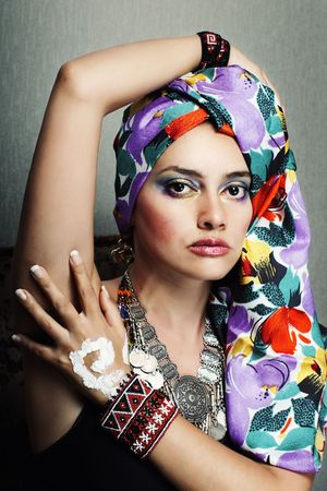 Fashion portrait of ethnic young woman with vivid head scarf and bracelet Stock Photo - 6767899