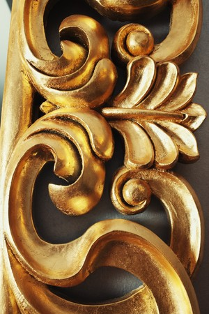 wood molding: Closeup of golden stucco decoration in curve shape