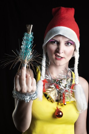 Out of focus bad Christmas girl showing middle finger  photo
