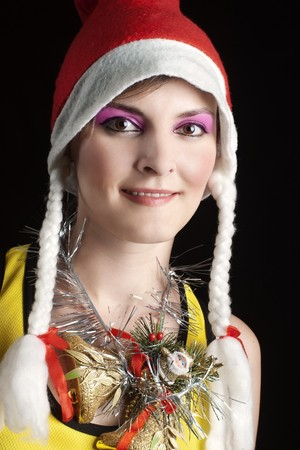 Cute Christmas girl with plaits and jingle bells on her neck against black Stock Photo - 7289337