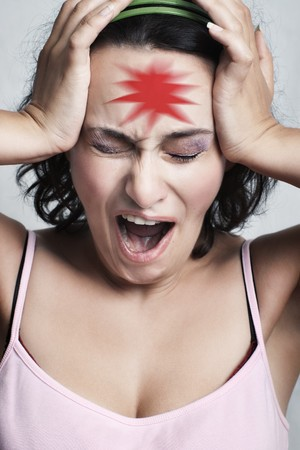 young woman screaming with closed eyes and red pain mark on her forehead with selective focus photo