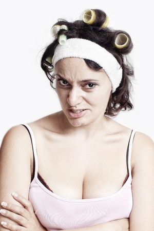 Angry evil housewife with curlers in her hair  photo