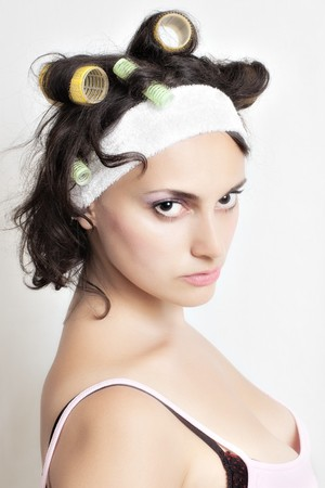 Portrait of housewife with curlers in her hair  photo