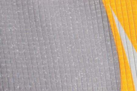 Seamless grey textile texture with white arrow on orange on side Stock Photo - 7487352