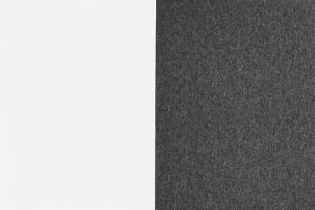 black paper texture next to white sheet photo