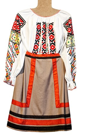 national folklore womans shirt and skirt isolated on white photo