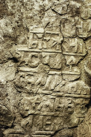 slavonic: Grungy ancient tombstone with old Slavonic inscriptions