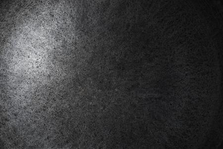 Closeup di ghisa pentola trama senza soluzione di continuit� con il fuoco e il decadimento della luce Archivio Fotografico