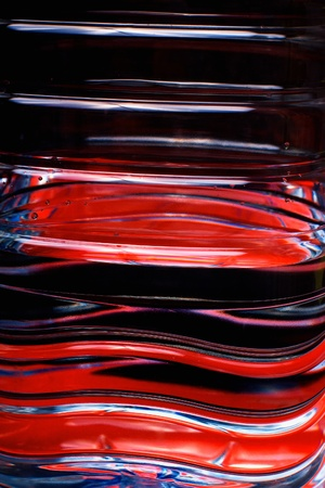 Closeup of red liquid in pet plastic bottle against dark background with selective focus Stock Photo - 8570579