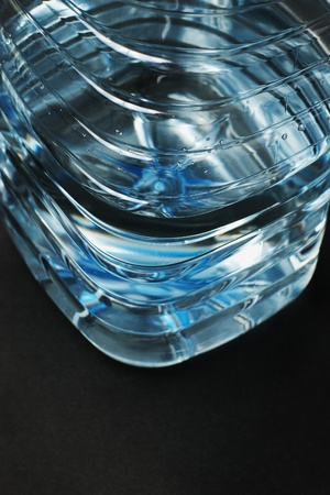 Water in blue pet plastic bottle on black background with selective focus Stock Photo - 8570575
