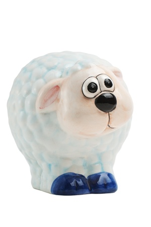 paschal lamb: Easter porcelain toy sheep looking aside isolated on white