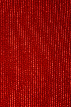 Vertical closeup of seamless red knitted fabric texture