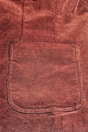 Closeup of big pocket on dark red velvet suit photo