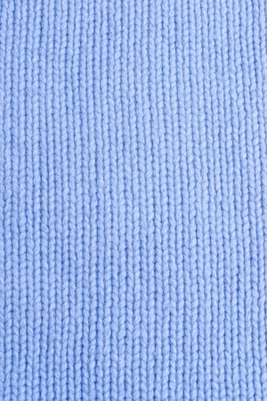 Vertical closeup of seamless blue knitted fabric texture