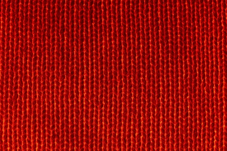 closeup of seamless red knitted fabric texture photo