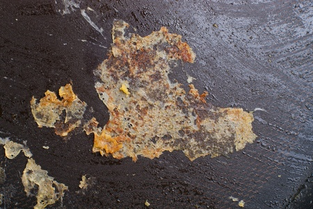 Closeup of surface of frying pan with scorched food stain Stock Photo