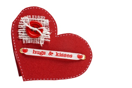 Handmade paper valentine card with button and hugs and kisses words isolated on white with copy space photo