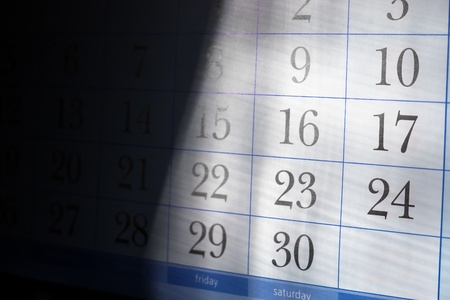 end month: Part of calendar with month end dates with shallow depth of field and half in deep shadow Stock Photo