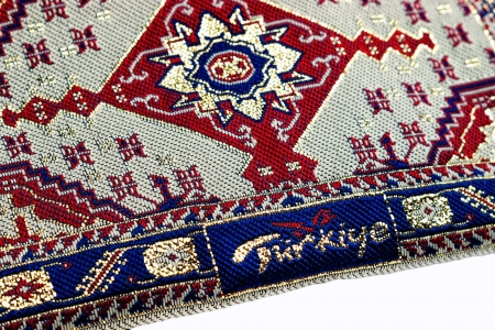 closeup of seamless red oriental embroidery pattern with turkiye word on white with selective focus photo
