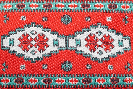 Closeup of seamless red oriental embroidery pattern photo