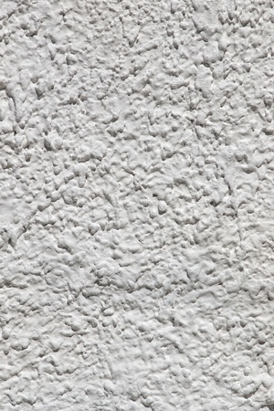 Vertical closeup of white plaster textured wall background Stock Photo - 9403618