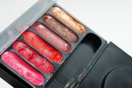 Closeup of used makeup kit with poor quality melting eye shadows and selective focus Stock Photo - 9738878