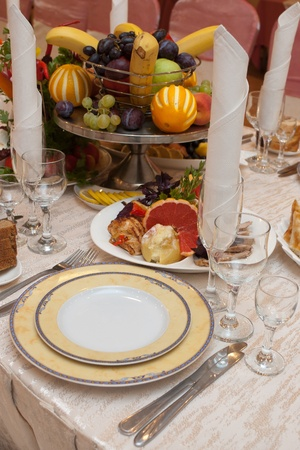 Table appointment with appetizers on a banquet table with selective focus photo