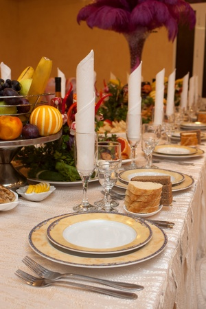 Table appointment with appetizers on a banquet table with shallow depth of field photo