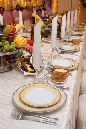 Table appointment with appetizers on a banquet table with selective focus