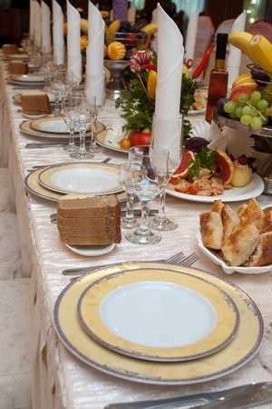 Row of plates and appetizers on a banquet table with shallow depth of field photo
