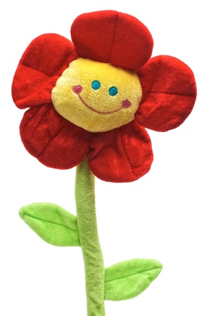 Smiling flower toy with green leaves isolated on white