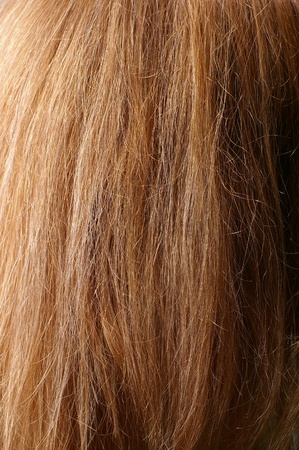 Closeup of red chestnut natural hair with selective focus and light falloff photo