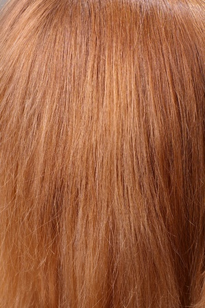 Part of red chestnut natural hair closeup texture with selective focus photo