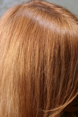 Closeup of red chestnut natural hair with selective focus Stock Photo