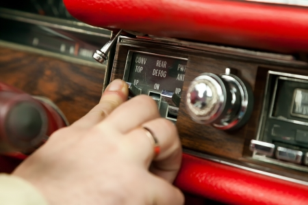 Switching convertible top button on an old vintage car with selective focus