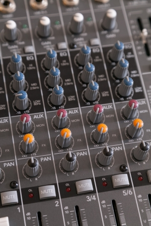 master volume: Closeup of audio mixer with filter knobs and selective focus Stock Photo