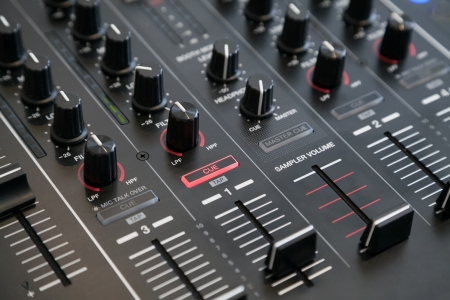 master volume: Closeup of audio mixer with selective focus Stock Photo