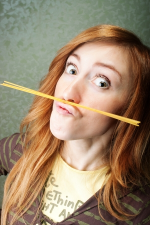 Funny young woman with spaghetti moustache photo